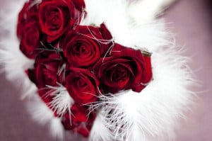 red rose bride bouquet with white feather collar