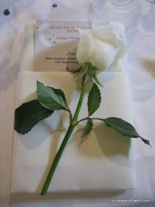 Romantic wedding flowers. Classic white napkin dress with a singel white rose